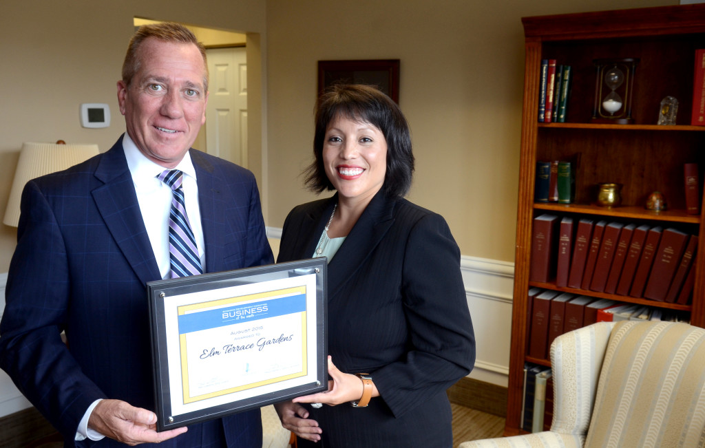 Geoff Patton--The Reporter Elm Terrace Gardens CEO Tim Murphy, left, with Traci Connelly, Director of Public Relations and Development with Lansdale's Business of the Month award for August 2015 presented by the Economic Development Committee Thurday August 20, 2015.